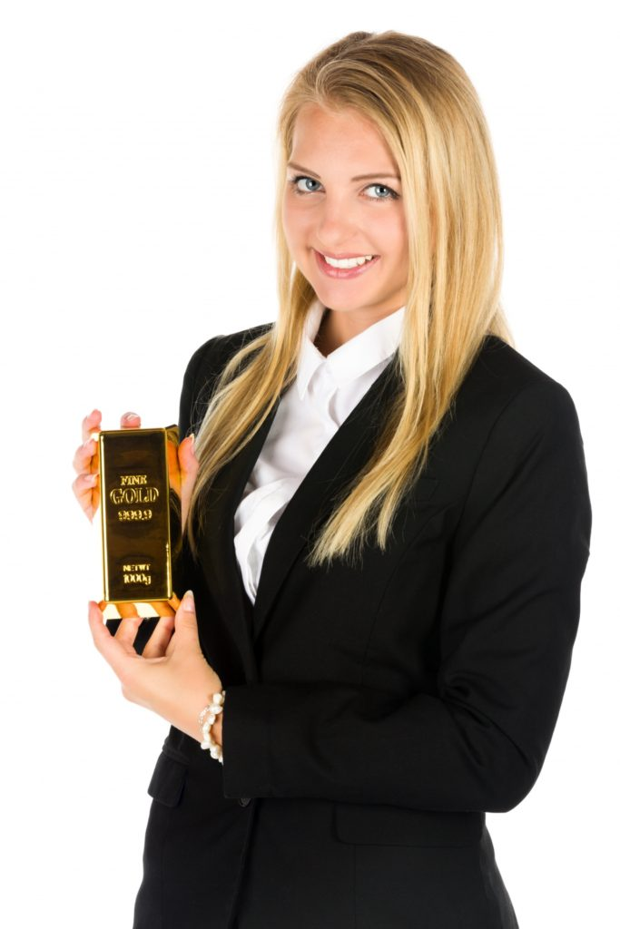 business-woman-and-a-gold-bar-1470483223KUH